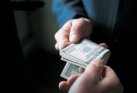 Phải trị vấn nạn tham nhũng như thế nào? Ảnh minh họa
