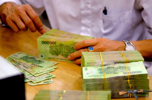 Tái cơ cấu nền kinh tế, trong đó có tái cơ cấu hệ thống ngân hàng là nhiệm vụ lớn của năm 2013. Ảnh: Hoàng Hà.